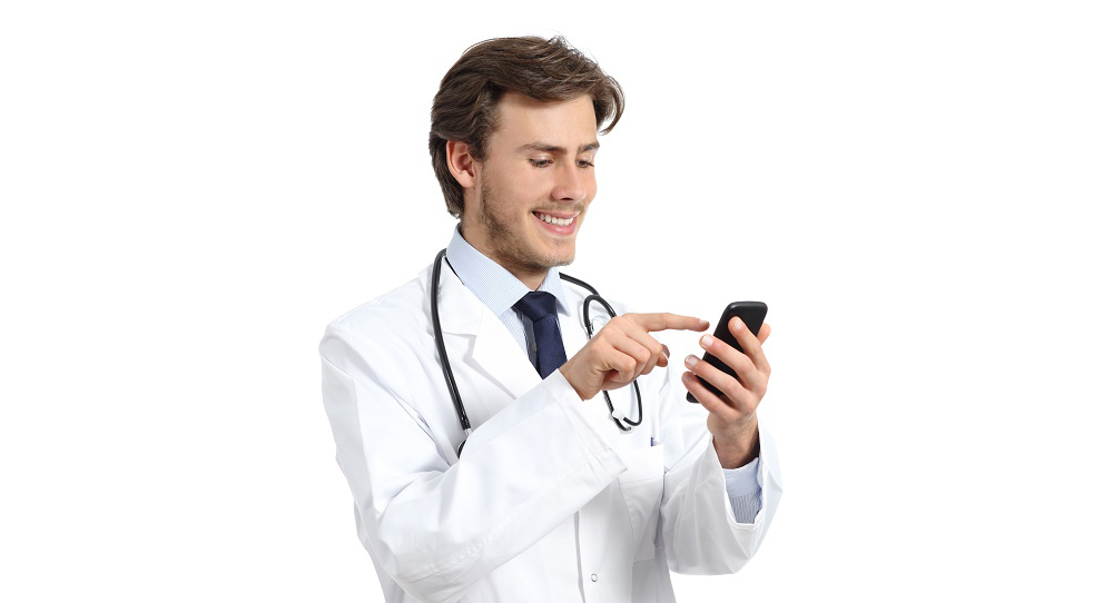 Happy doctor man texting on a smart phone isolated on a white background